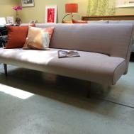Unfurl sofa/bed heavy natural w/black piping floor model $999