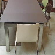 "Orione extendable dining table.  Acid etch grey glass w/satin nickel base. 63""L x 35.5""W x 30""H extends to 81""& 98"" $1899"