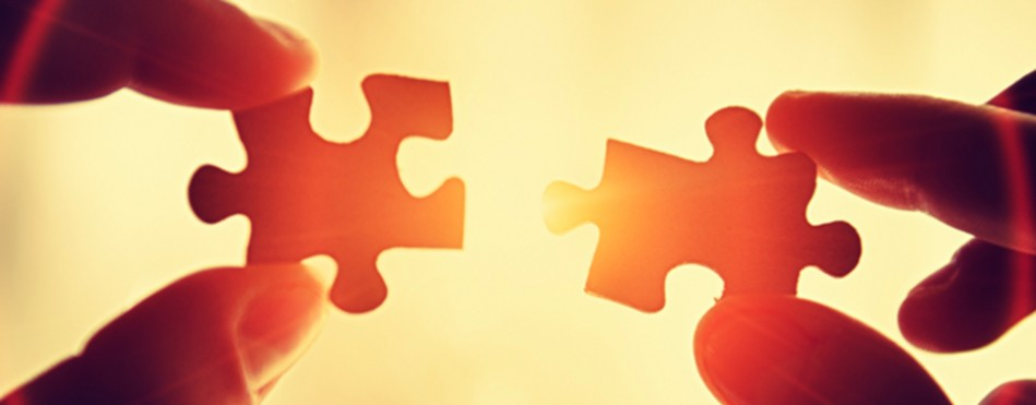 slide_two_puzzle_pieces_coming_together_small-949x371