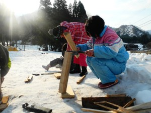 Participants splitting kindling for the first time in order to create a fire. It was a difficult moment for them!