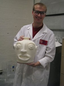 MSOE staff member Jordan Weston shows the finished rapid-prototyped piece constructed of sintered nylon.