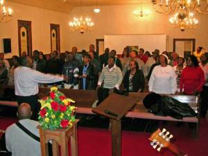Leon DeBerry shows energy in the directing of the Mass Choir as they practiced at Macedonia Monday evening.