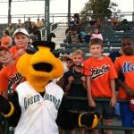 Teams posing with Auggie the Greenjackets mascot.