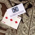 The cards Rob keck drew that settled his fate in the battle. The playing card was coded by color and number.