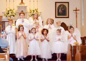 The tour starts at the Catholic Church where last year these angels appeared to help tell the story.