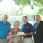 Receiving a grant check on behalf of the Ridge Spring Farmers Market is (L to R)  Tom Quattlebaum, Harriett Fripp Householder, Matt Riddle with AgSouth Farm Credit and Michael Crim