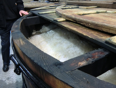 A wooden wash back fermenting