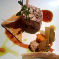 Pheasant terrine with melba toast and perfect pickles.