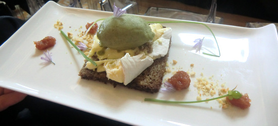 Wild garlic sorbet with clare brie cheese on rye bread with hazelnuts