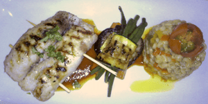 Swordfish roulade with grilled vegetables and orzotto.