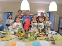 Robin Ellis and participants at his cookery schoo