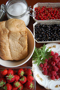Sugar, bread and berries: summer pudding ingredients.