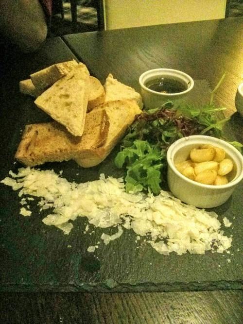 Artisanal breadboard - note the generous ramekin of roasted garlic