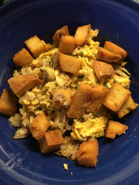 A quick supper of peppered smoked mackerel, scrambled eggs and croutons