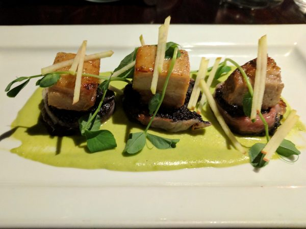 The matchisticks of apples on top of the pork belly are fresh and crunchy: the black pudding below is rich and soft.