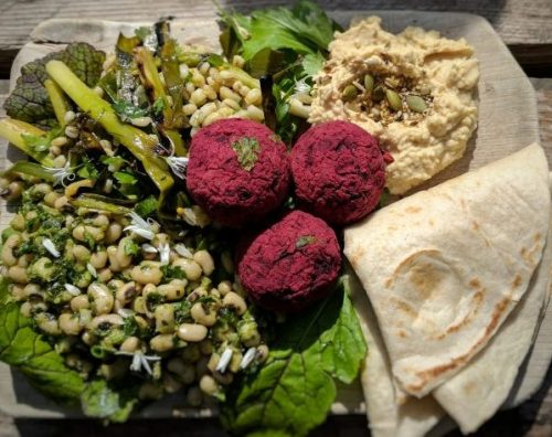 Beetroot falafel with wheat salad, hummous and flat bread at Earthy.