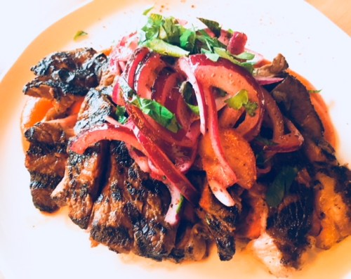 Chuck-eye steak, sumac onion salad and red pepper ketchup