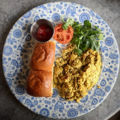 Getting ready for the day with oodles of spicy scrambled eggs, rolls and lashings of chai.