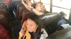 Michelle playing her guitar on a public bus!