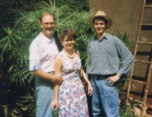 Gary, Marilyn and Tim in front of their home in Uganda