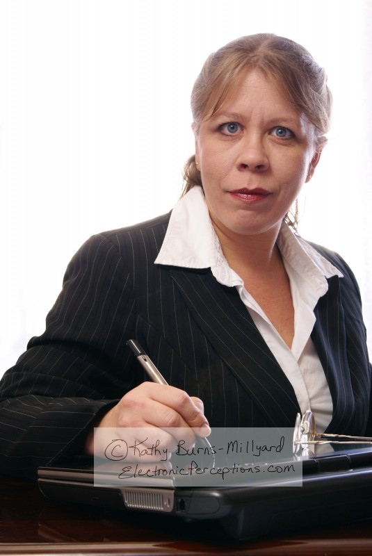 Female Business Executive With Tablet PC - Stock photography ©Kathy Burns-Millyard