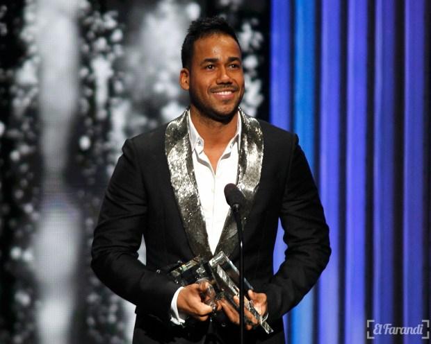 Singer Romeo Santos accepts a pair of awards at the 2015 Latin Billboard Awards in Coral Gables, Florida April 30, 2015. REUTERS/Carlo Allegri