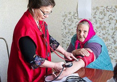 8 People wait for a doctor's consultation in front of an old building that functions as a primary health care facility in Synykha village, Ukraine. Halyna, 70, cries. She has heart disease, but it is almost impossible for her to visit a doctor.