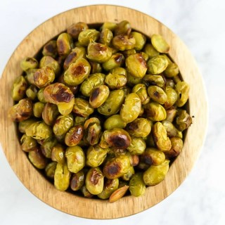 Ditch the chips and reach for a handful of these Salt and Vinegar Roasted Edamame! They're crispy, flavorful, and make a great vegan protein-packed snack.