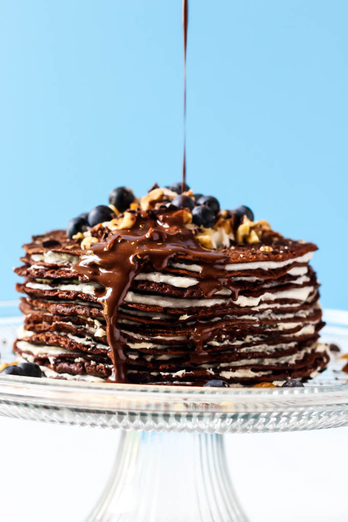 This Chocolate Crepe Cake is sure to stand out at any party! Made with wholesome ingredients, this vegan & gluten-free cake is a healthier way to indulge.