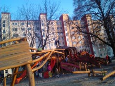 Behind the playground, see the panelák.