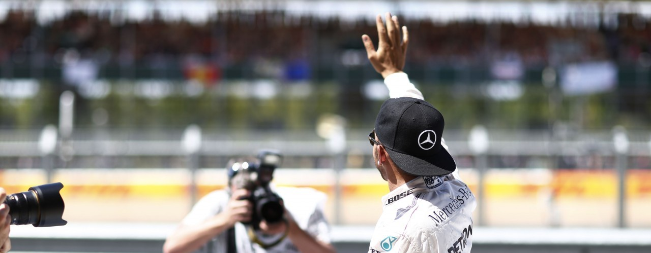 Lewis Hamilton waving at British F1 fans