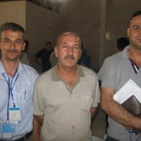 July 26, 2009 - Ahmed M. and Ahmed K. pose with Kak Anwar, the General Director of Sulaymaniyah's IHEC (Independent High Electoral Commission) office.