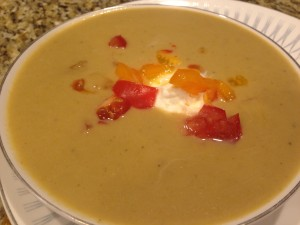 Delicious cauliflower soup with creme fraiche and chopped tomatoes.