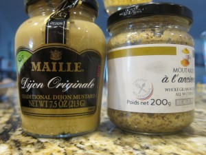 Mustard is a staple in our house.  We use a lot of it.  We have found that having a Dijon and a grainy mustard is enough as you can always sweeten with honey.