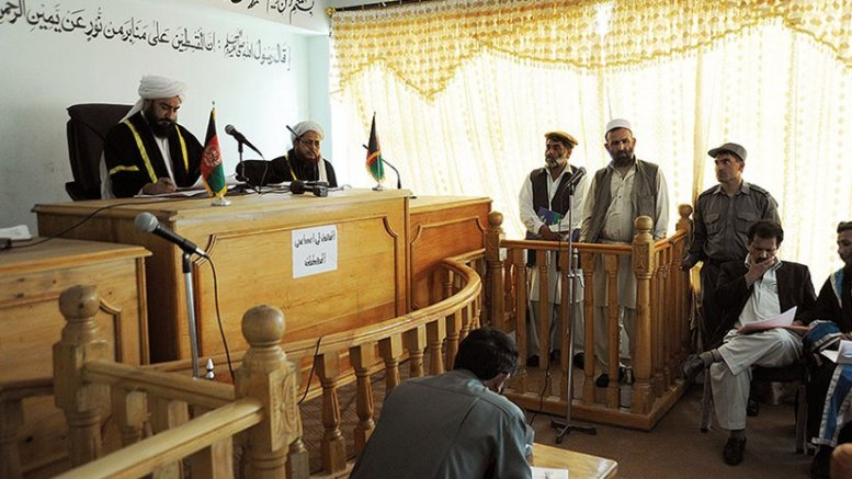 Khas Kunar chief of police was charged with misuse of his position (1 year in prison) and logistics officer was charged with corruption (61 months and fine) during rare public trial at Kunar provincial courthouse (U.S. Air Force/Christopher Marasky)