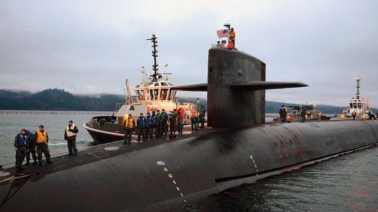 Blue crew of Ohio-class ballistic missile submarine USS Nevada prepares to moor as submarine returns home to Naval Base Kitsap-Bangor following strategic deterrent patrol (U.S. Navy/Ahron Arendes)