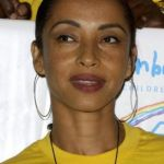 sade yellow shirt