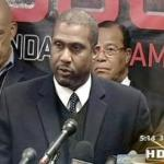 Tavis Smiley (at mic) with Tom Burrell, Minister Farrakhan &amp; Jesse Jackson