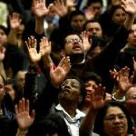Blacks and Latinos worshipping together