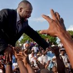 Haitian-born singer Wyclef Jean greets supporters after submitting the paperwork  to run for president of Haiti in the next elections in Port-au-Prince, Haiti, Thursday, Aug. 5, 2010.