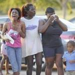 Family members of drowned teenagers react with grief