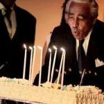 The Honorable Charlie Rangel blows out candles on birthday cake