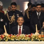 President Barack Obama (C) sits alongside India's Prime Minister Manmohan Singh (L) and President Pratibha Patil during a state dinner at Rashtrapati Bhavan in New Delhi November 8, 2010.