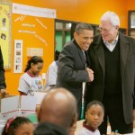 President Obama and Lakers Coach Phil Jackson share a laugh during a visit to a Washington, DC, Boys and Girls Club on Monday.