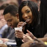 Singer and actress Brandy looks on during an NBA basketball game between the Toronto Raptors and the New York Knicks Wednesday, Dec. 8, 2010, in New York. The Knicks won the game 113-110.