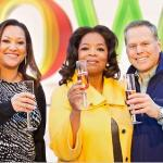 Oprah Winfrey with Christina Norman, C.E.O. of OWN, and David Zaslav, president and C.E.O of Discovery Communications