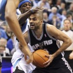 San Antonio Spurs guard Tony Parker (R) drives to the basket past Minnesota Timberwolves guard Jonny Flynn (L) during the first half of their NBA basketball game at Target Center in Minneapolis, January 11, 2011.