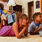 african-american family watching TV