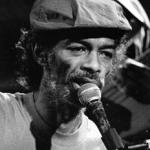 gil_scott-heron(2005-headshot-at-mic-b&w-med)