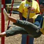 U.S. first lady Michelle Obama rides in a swing while helping to construct a playground at the Imagine Southeast Public Charter Elementary School June 15, 2011 in Washington, DC.